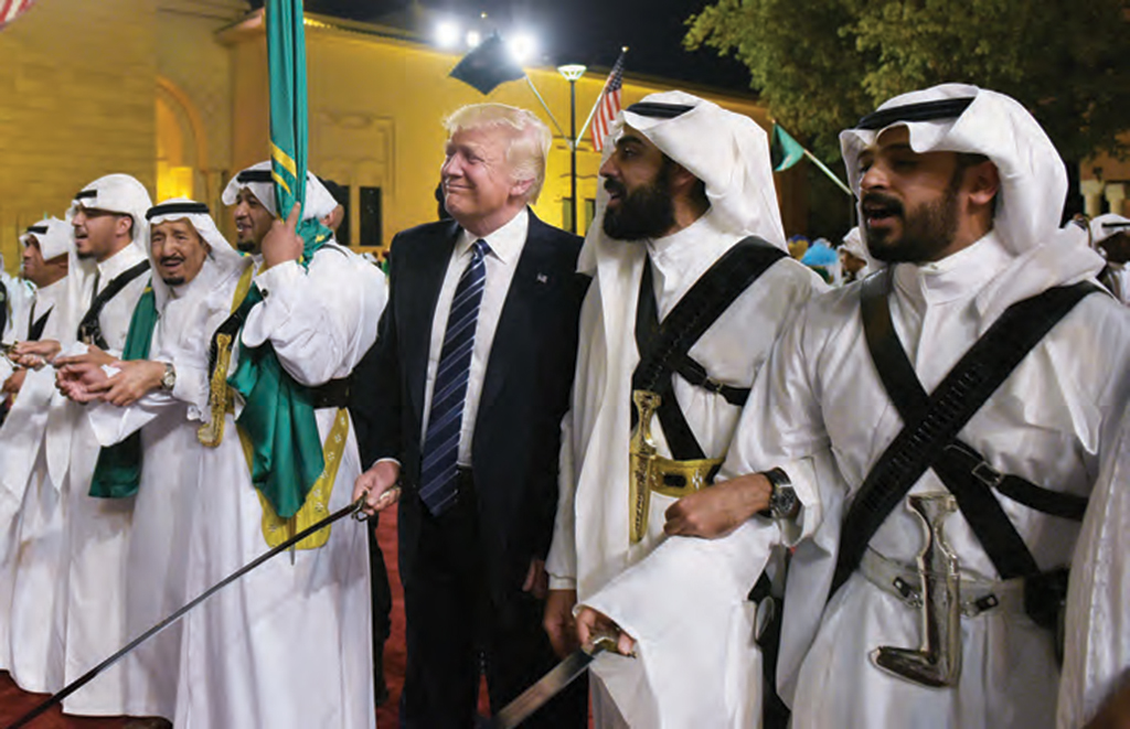 U.S. President Donald Trump joins a traditional sword dance at a welcome ceremony ahead of a banquet at the Murabba Palace in Riyadh on May 20, 2017.  AFP PHOTO /  MANDEL NGAN